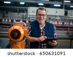 portrait of smiling factory... | Shutterstock . vector #650631091