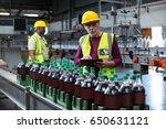 factory worker with digital... | Shutterstock . vector #650631121