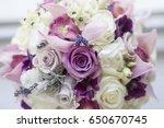 bride wedding bouquet of roses | Shutterstock . vector #650670745