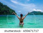 happy woman in bikini playing... | Shutterstock . vector #650671717