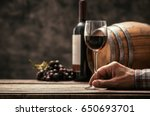 senior wine maker tasting a... | Shutterstock . vector #650693701