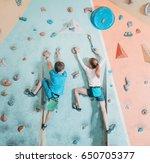 two children climbing on... | Shutterstock . vector #650705377