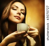 beautiful woman drinking coffee | Shutterstock . vector #65070727