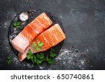 raw salmon fish fillet on black ... | Shutterstock . vector #650740861