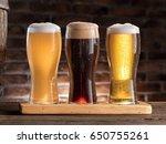 glasses of beer on the wooden... | Shutterstock . vector #650755261