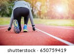 athletic woman on running track ... | Shutterstock . vector #650759419