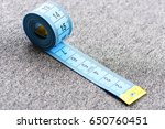 Small photo of Tape for measuring on light grey background. Concept of accuracy and metering