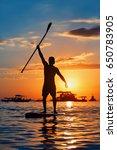 paddle boarder. black sunset... | Shutterstock . vector #650783905