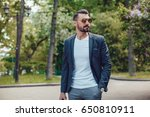 stylish man with a beard and in ... | Shutterstock . vector #650810911