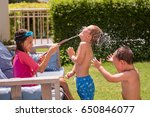 children pour water from the... | Shutterstock . vector #650846077