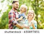 happy family of three enjoying... | Shutterstock . vector #650897851