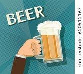 human hand holds a mug of beer. ... | Shutterstock . vector #650915167