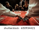 Small photo of close up view of dealer shuffling cards in hands