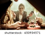 confused man with poker cards... | Shutterstock . vector #650934571