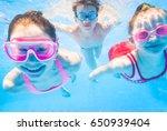 little kids swimming  in pool | Shutterstock . vector #650939404