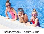 little kids swimming  in pool | Shutterstock . vector #650939485