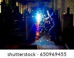welder at a factory | Shutterstock . vector #650969455