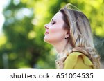 beautiful woman with blond hair ... | Shutterstock . vector #651054535