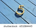 House Number 5 At A Wooden Door