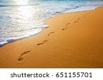 beach  wave and footsteps at... | Shutterstock . vector #651155701