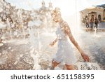 girl in a spray of water in a... | Shutterstock . vector #651158395