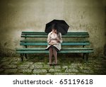 woman sitting on a park bench... | Shutterstock . vector #65119618