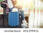 alone traveler wait suitcases... | Shutterstock . vector #651199411