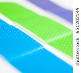 three bright adhesive bandages... | Shutterstock . vector #651202549