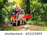 happy asian young travellers... | Shutterstock . vector #651225859