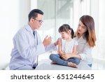 little asian girl receiving... | Shutterstock . vector #651244645