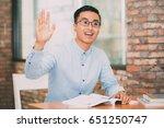smiling student raising hand to ...   Shutterstock . vector #651250747