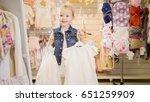 shopping for kids. the girl is... | Shutterstock . vector #651259909