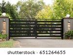 black metal driveway entrance... | Shutterstock . vector #651264655