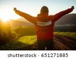 happy girl meeting sunrise in...   Shutterstock . vector #651271885