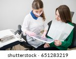 young dentist talking with... | Shutterstock . vector #651283219