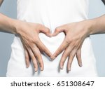 young woman who makes a heart... | Shutterstock . vector #651308647