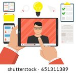 hands holding tablet with video ... | Shutterstock .eps vector #651311389