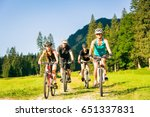 family of four cycling | Shutterstock . vector #651337831