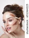 woman face makeup. closeup of... | Shutterstock . vector #651364225