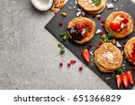 slate plate with stacks of... | Shutterstock . vector #651366829