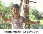 kid in hammock on nature | Shutterstock . vector #651398344