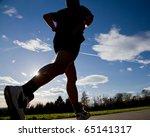 jogger running in back light | Shutterstock . vector #65141317