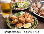 foods and draft beer at izakaya ... | Shutterstock . vector #651417715