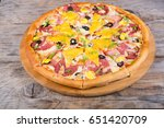 whole round pizza served on a... | Shutterstock . vector #651420709