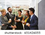 team making small talk in their ... | Shutterstock . vector #651426055