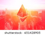Stock photo mixed image which are ethereum crypto currency and business building on vintage red color 651428905