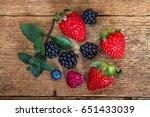 berries on wooden background | Shutterstock . vector #651433039