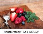 berries on wooden cutting board | Shutterstock . vector #651433069