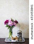 vase with peonies  tea pot with ...   Shutterstock . vector #651453841