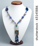 Blue necklace with agate - stock photo